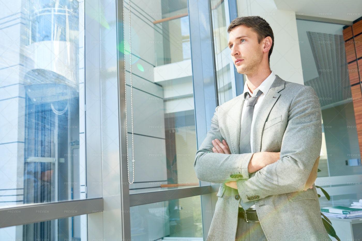 Successful Businessman By Window: Stock Photos