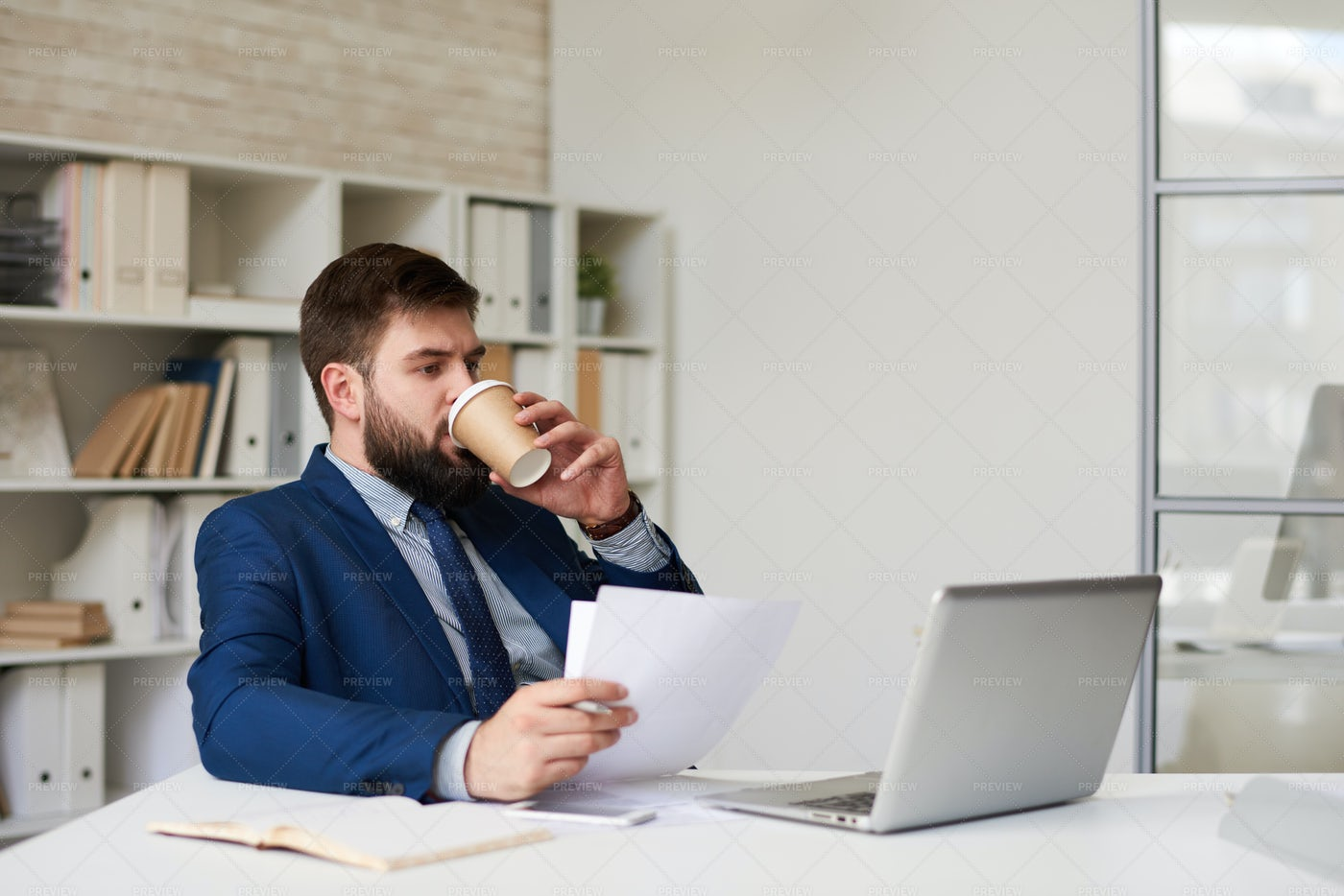 Modern Businessman Drinking Coffee...: Stock Photos