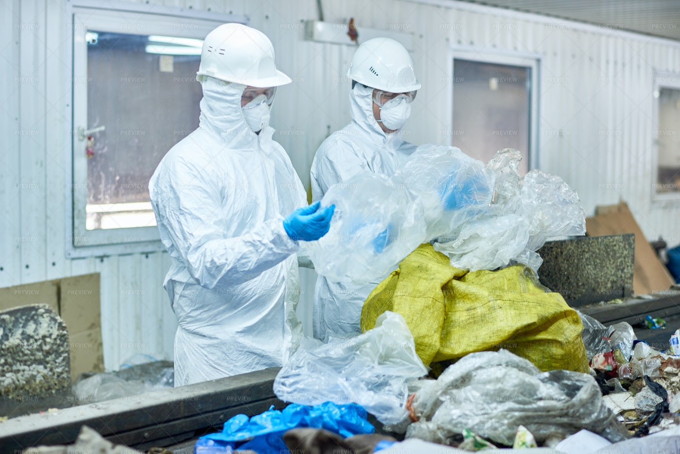 Workers On Waste Processing Plant: Stock Photos