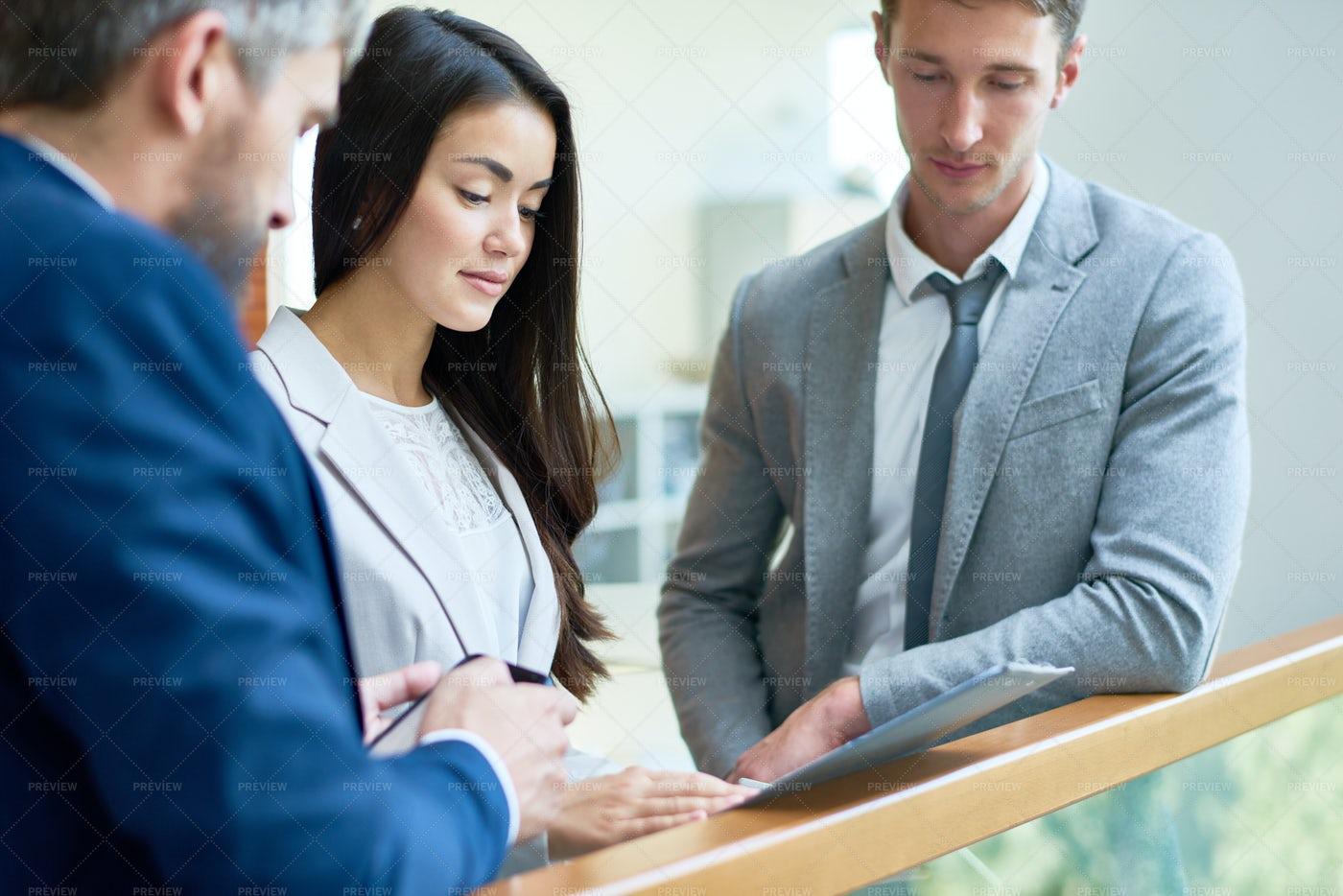 Informal Meeting At Office Lobby: Stock Photos