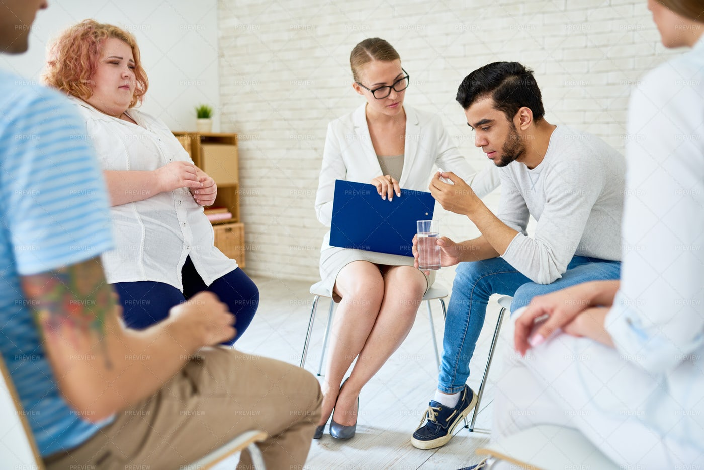 Young Man Opening Up In Group...: Stock Photos