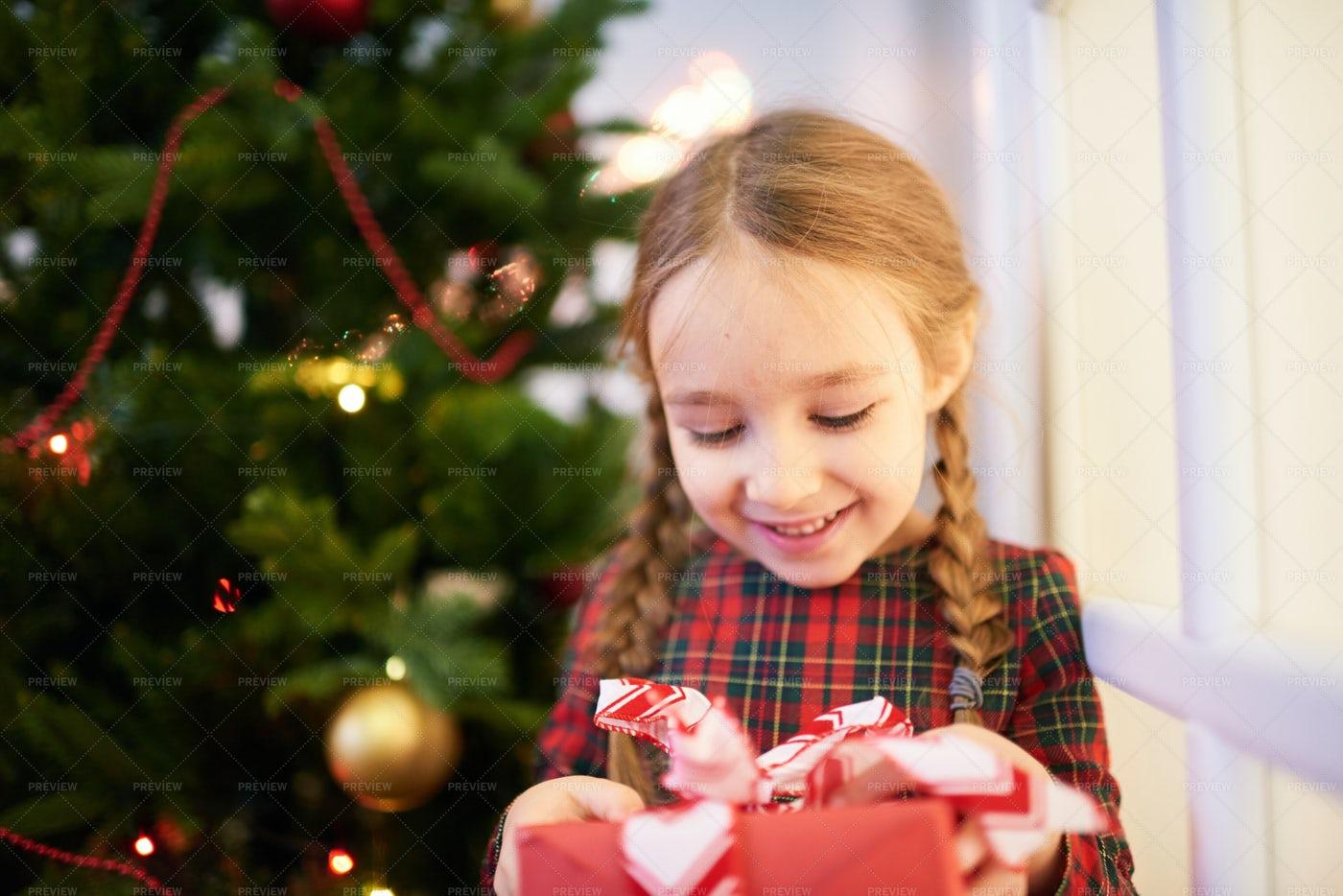 Opening Christmas Gift: Stock Photos