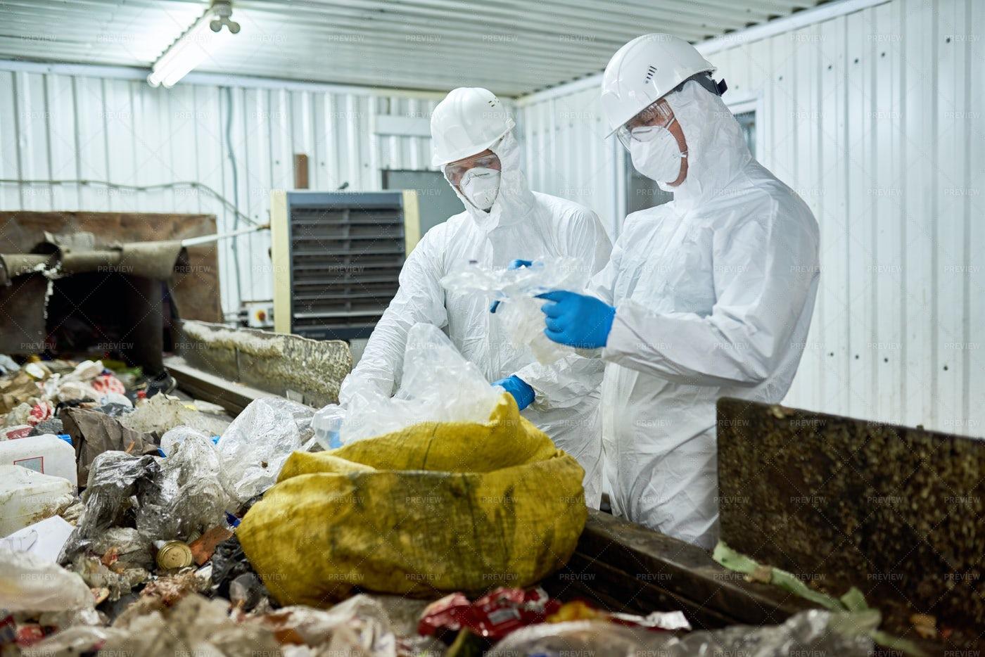 Workers Sorting Trash On Conveyor...: Stock Photos