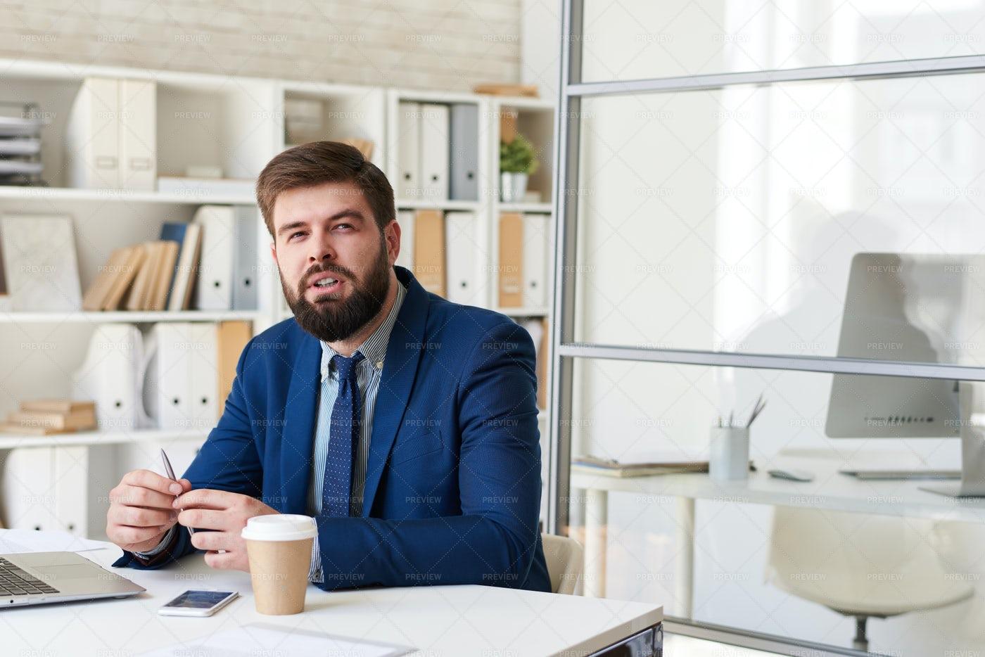 Modern Businessman Thinking At Desk...: Stock Photos