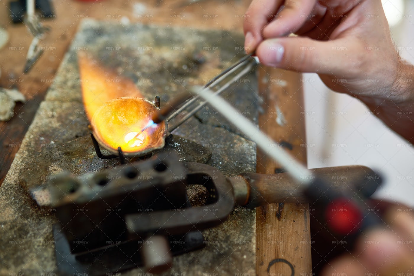 Hands Melting Metal: Stock Photos