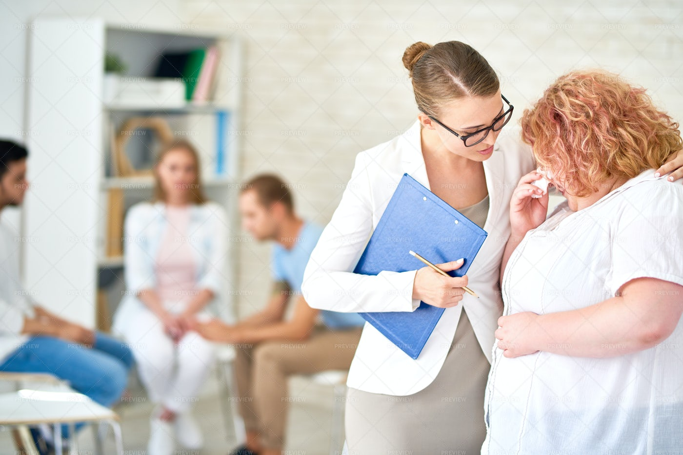 Obese Woman Talking One On One With...: Stock Photos