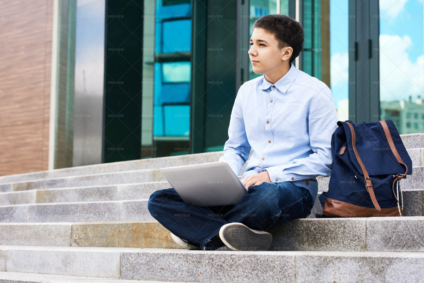 Pensive Schoolboy With Laptop...: Stock Photos