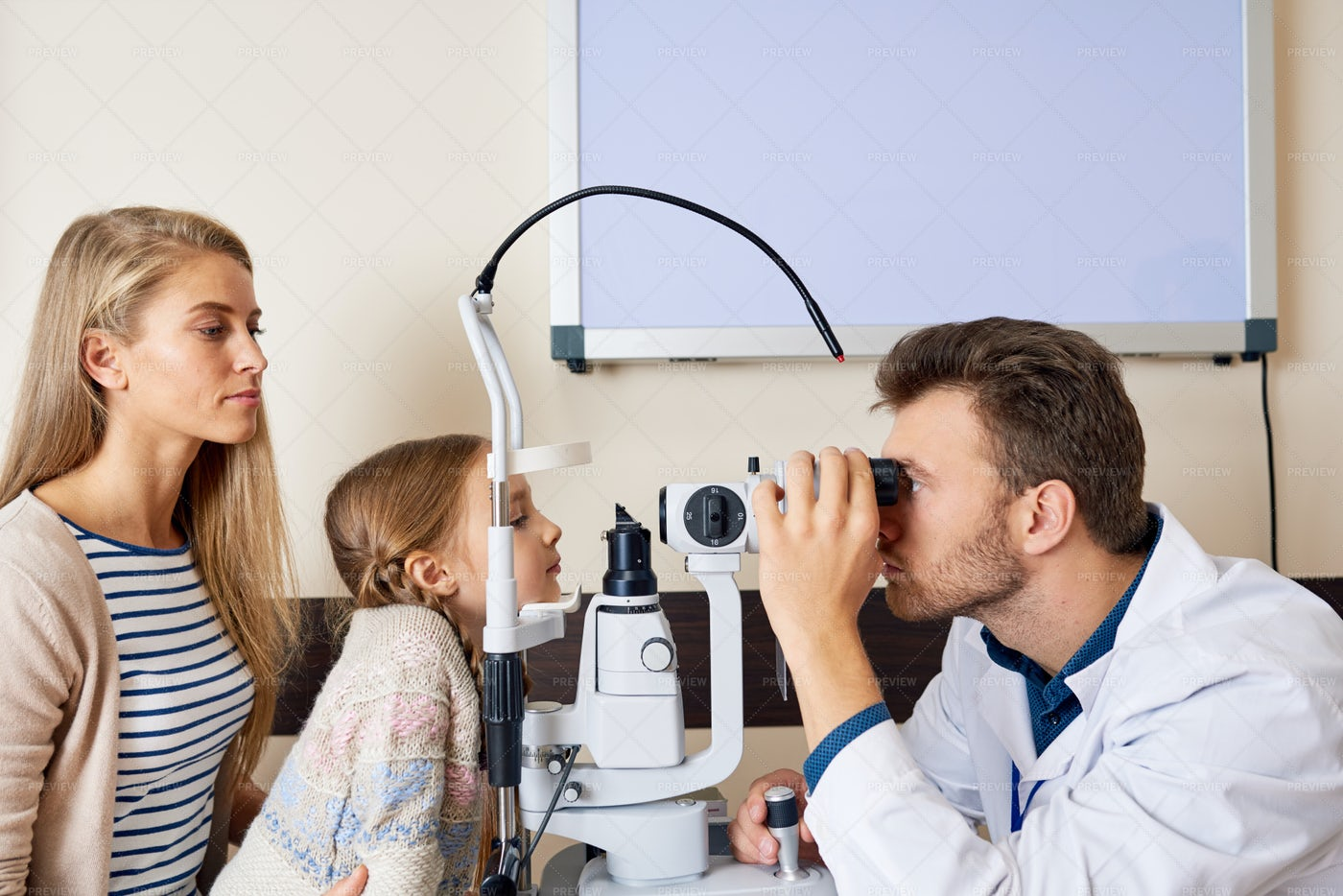 Little Girl At Eye Testing...: Stock Photos