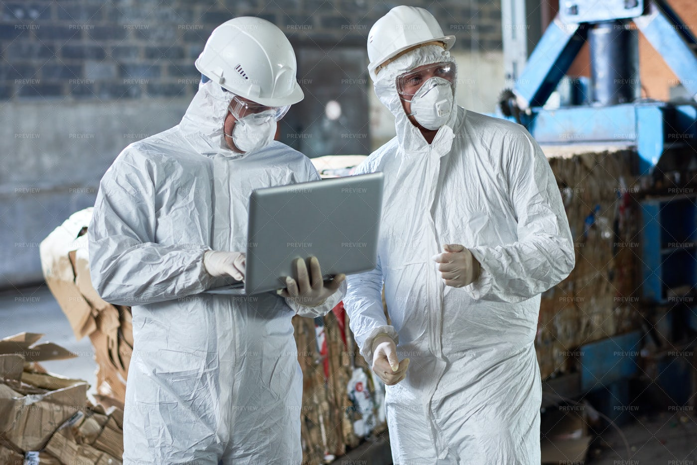 Workers In Hazmat Suits At Modern...: Stock Photos