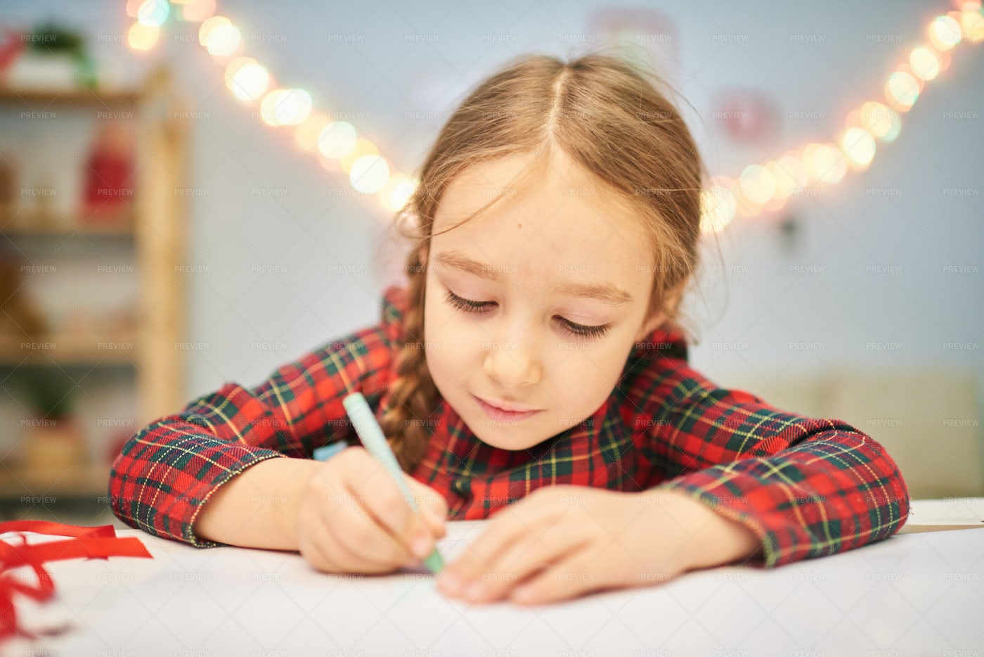 Focused On Drawing Christmas Card: Stock Photos