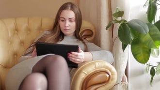 Woman Using A Digital Tablet: Stock Video