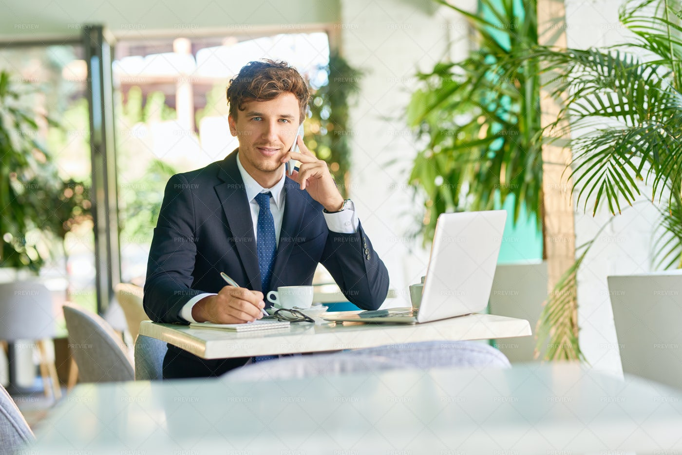 Successful Businessman Working In...: Stock Photos
