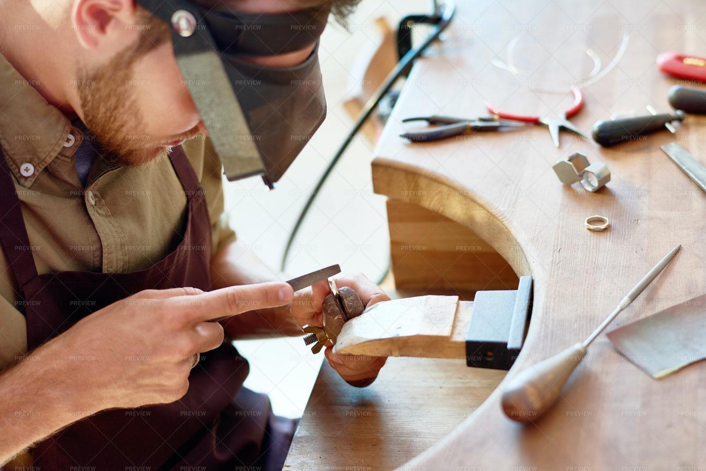 Young Jeweler Making Ring: Stock Photos