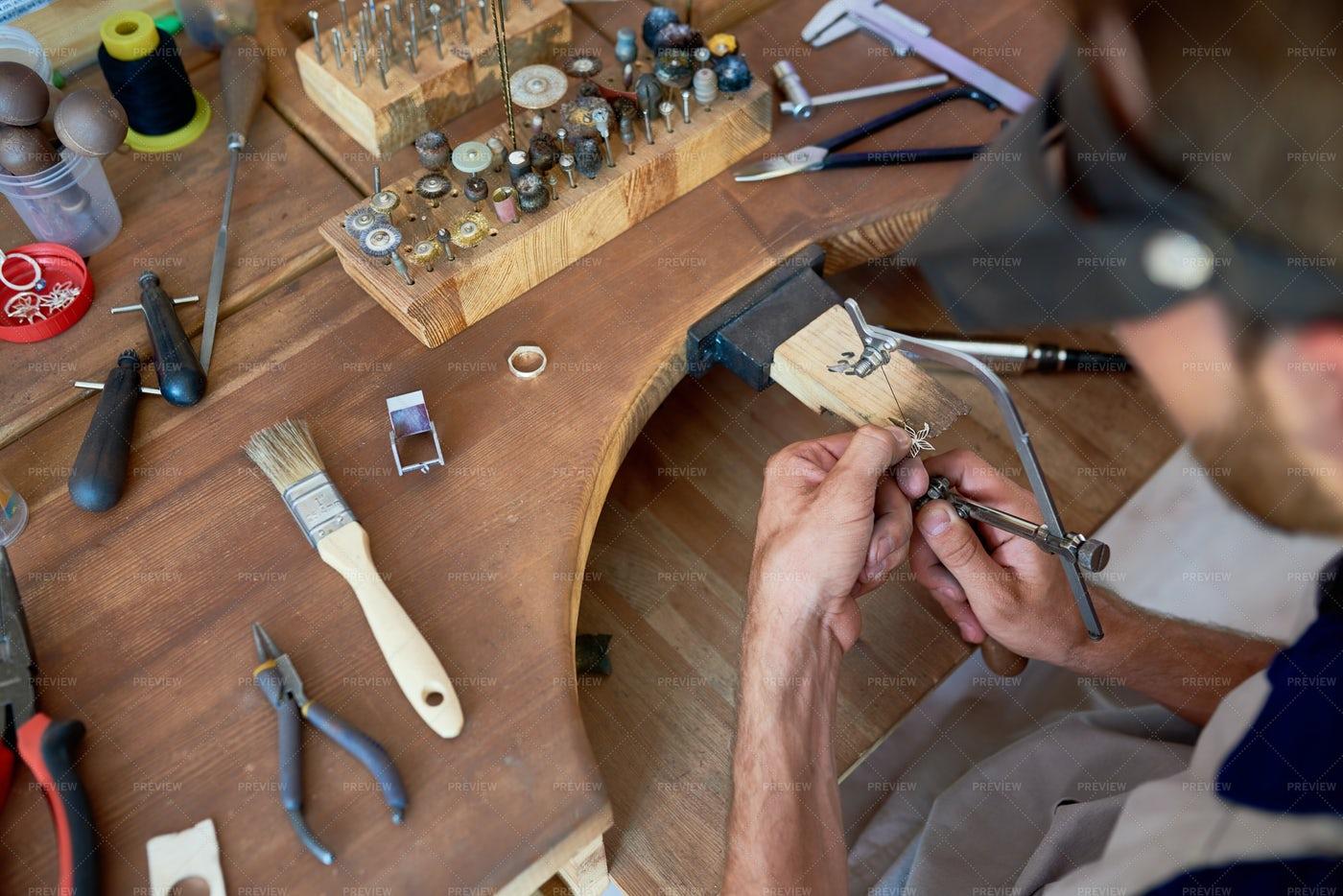 Craftsman Making Metal Flower: Stock Photos