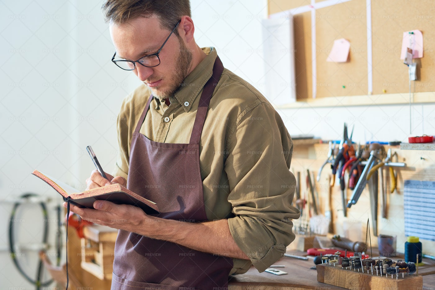 Man Drawing Sketches In Workshop: Stock Photos
