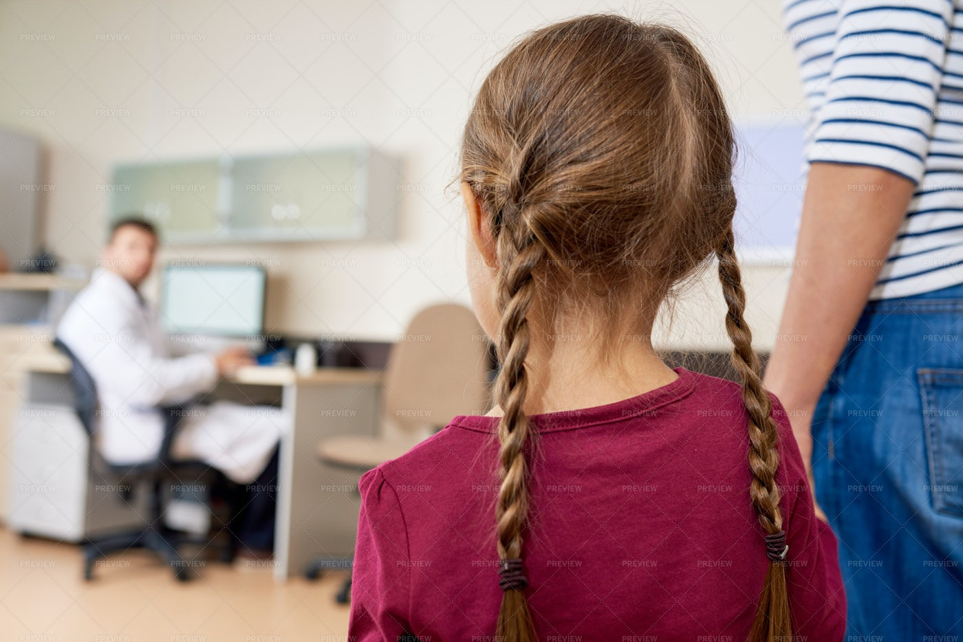Scared Little Girl Entering Doctors...: Stock Photos