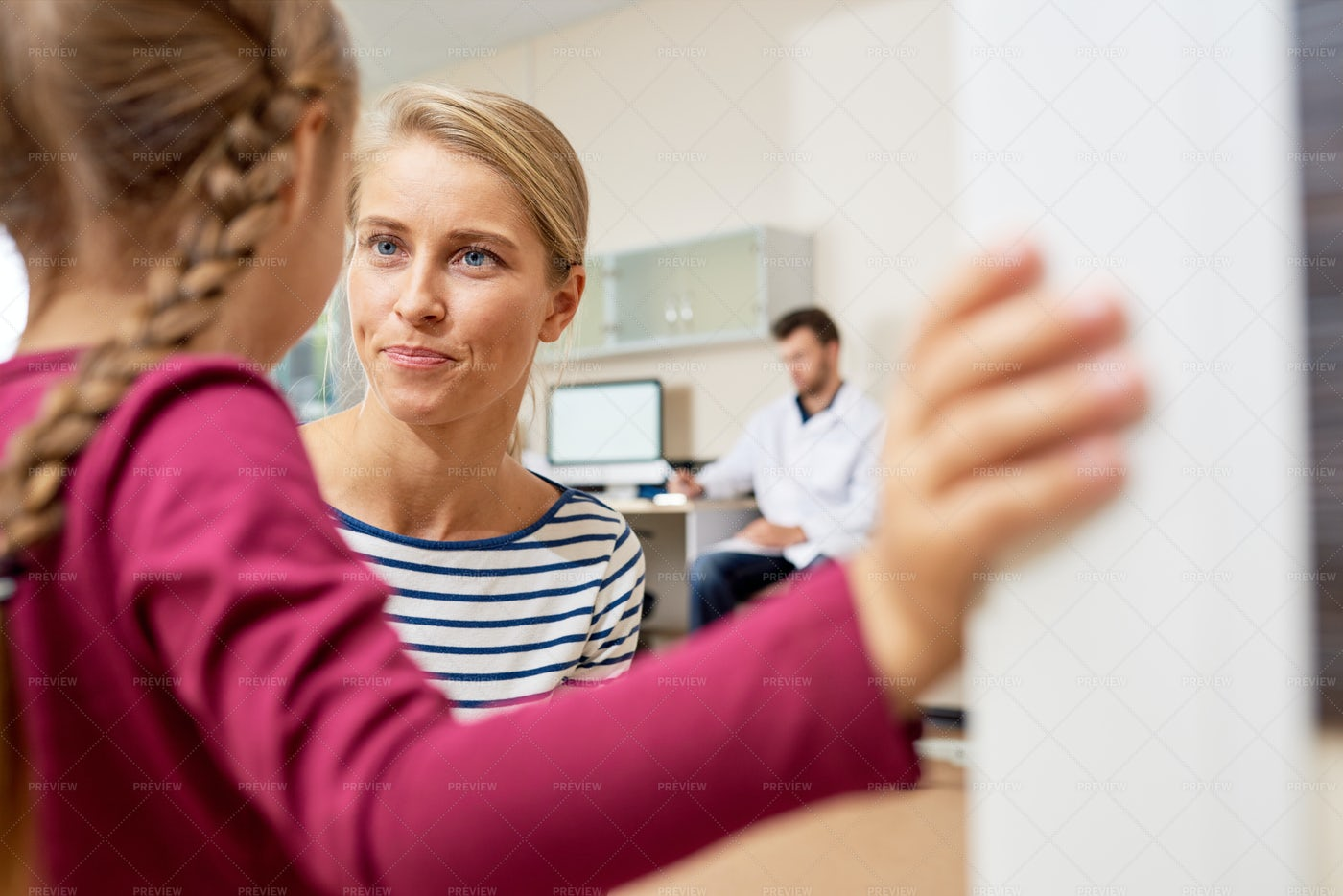 Mother Talking To Scared Little...: Stock Photos