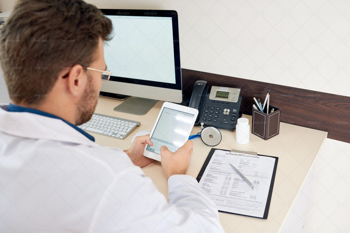 Doctor Working At Desk: Stock Photos