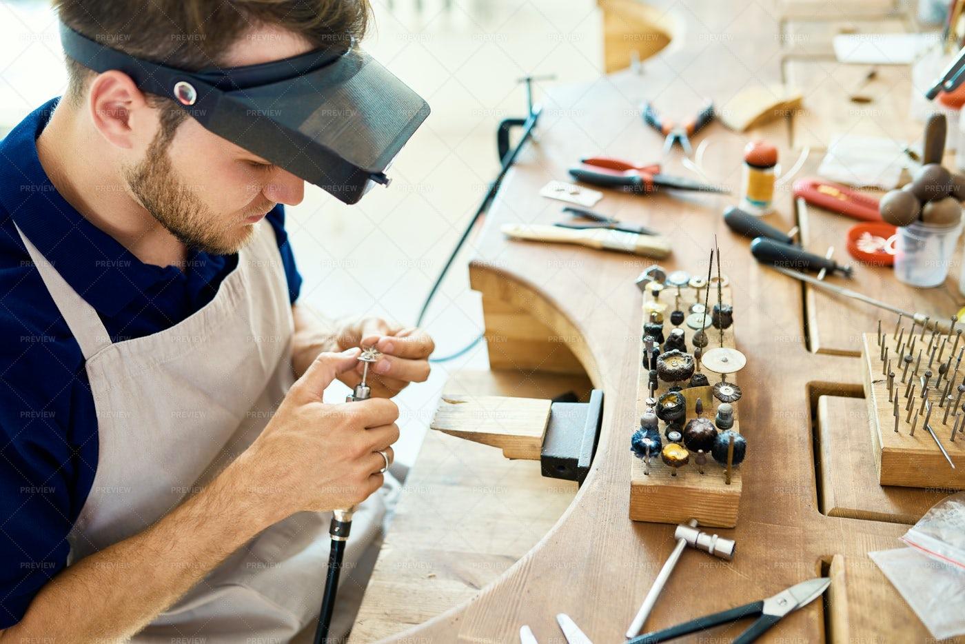 Artisan Making Rings In Workshop: Stock Photos