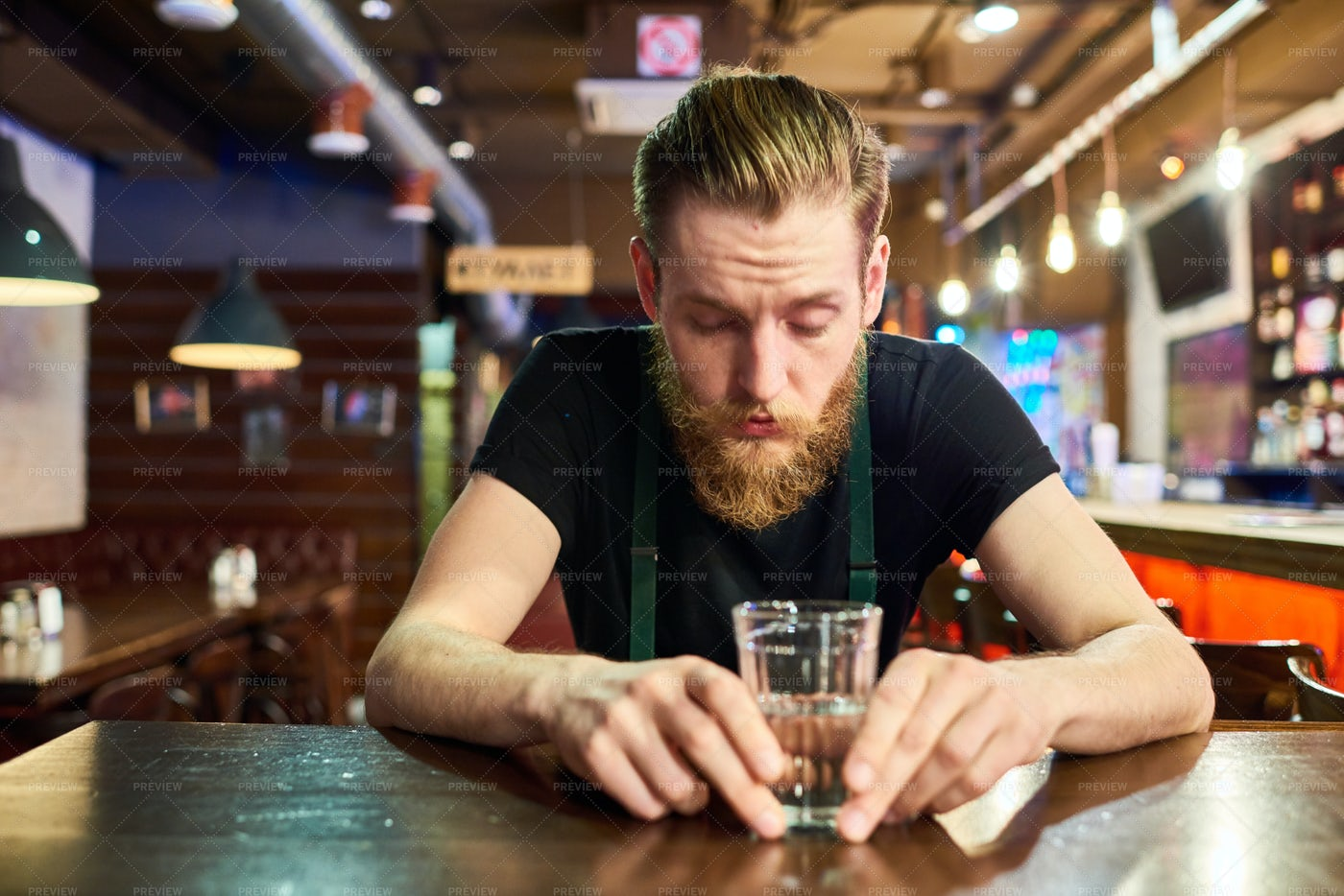 Young Bearded Man Getting Drunk In...: Stock Photos