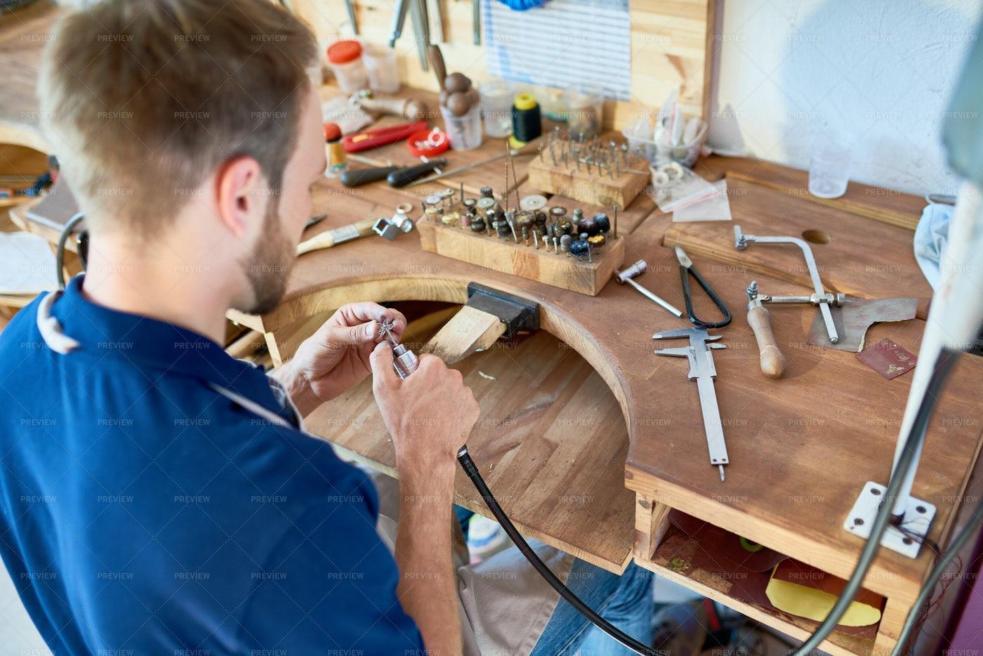 Jeweler Working At Table: Stock Photos