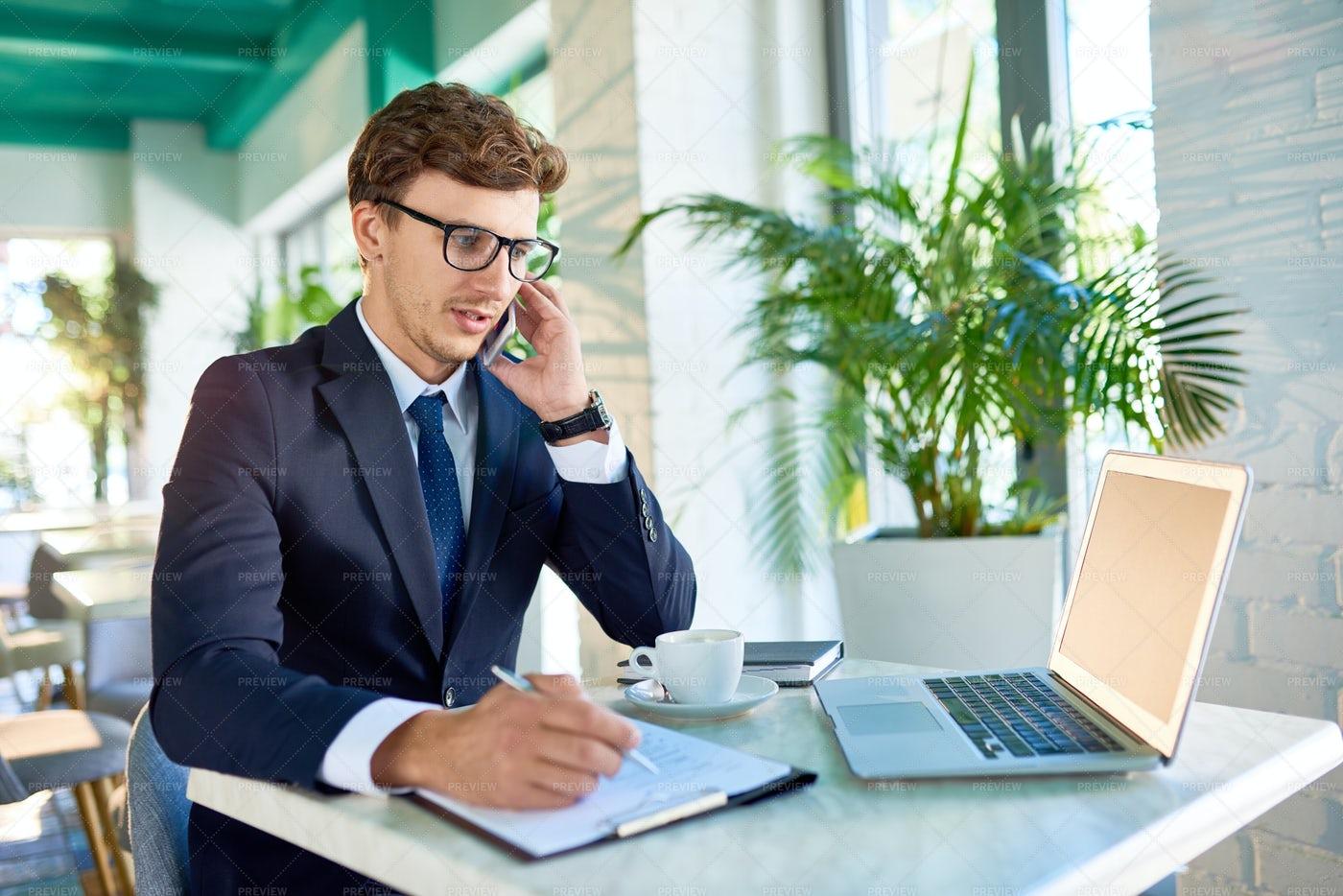 Modern Businessman Speaking By...: Stock Photos