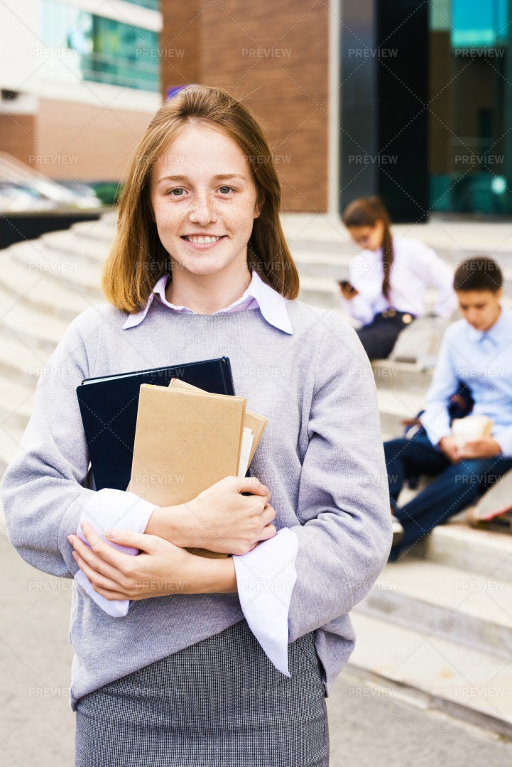 Ginger School Girl Smiling Happily...: Stock Photos