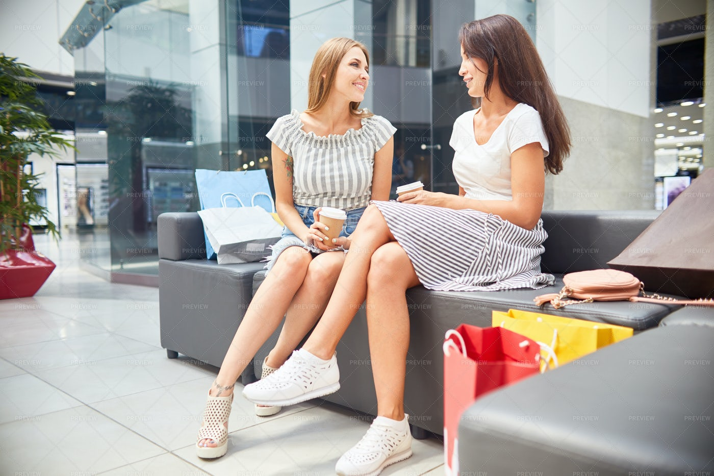 Two Girls In Shopping Mall: Stock Photos