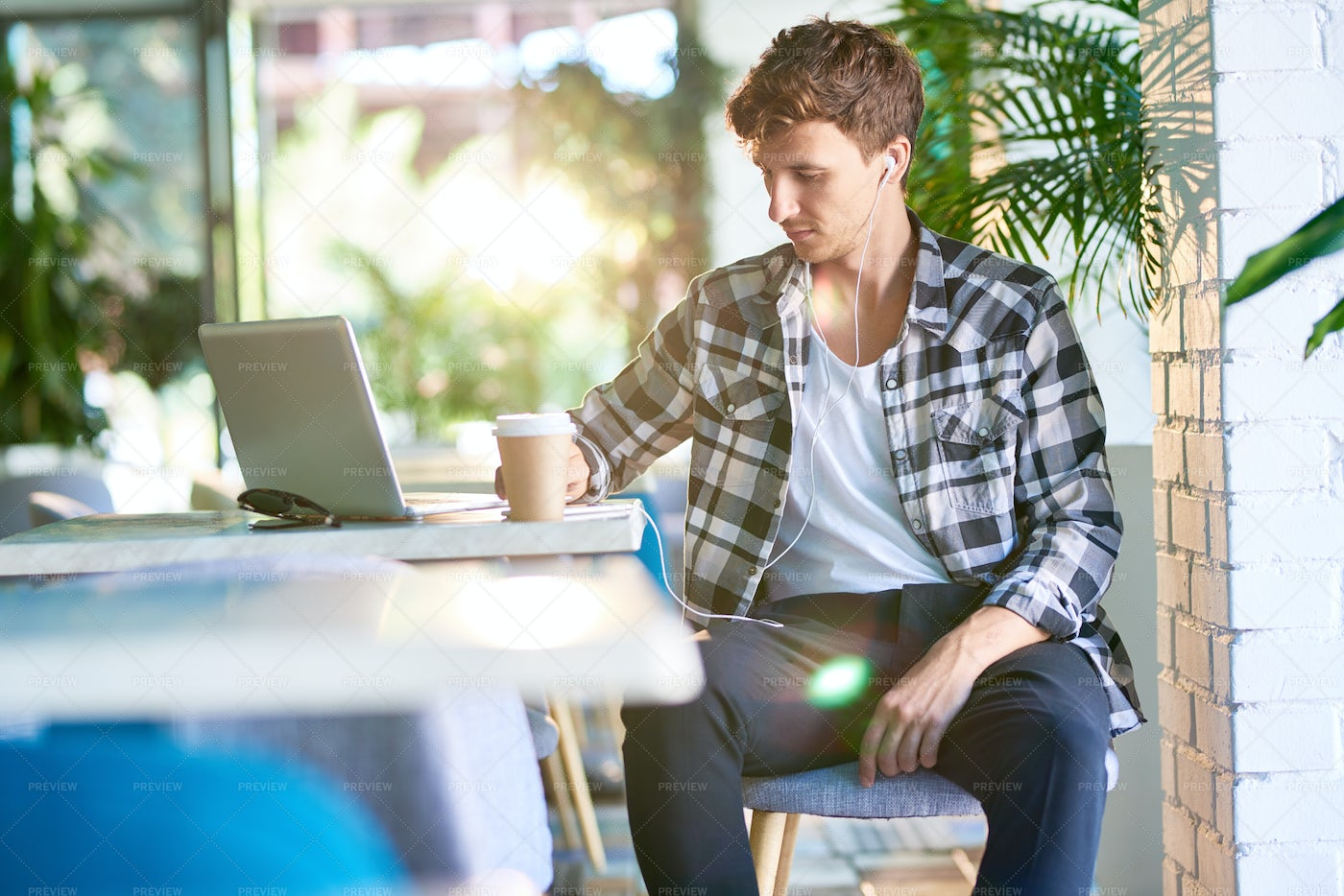 Young Man Relaxing In Cafe: Stock Photos