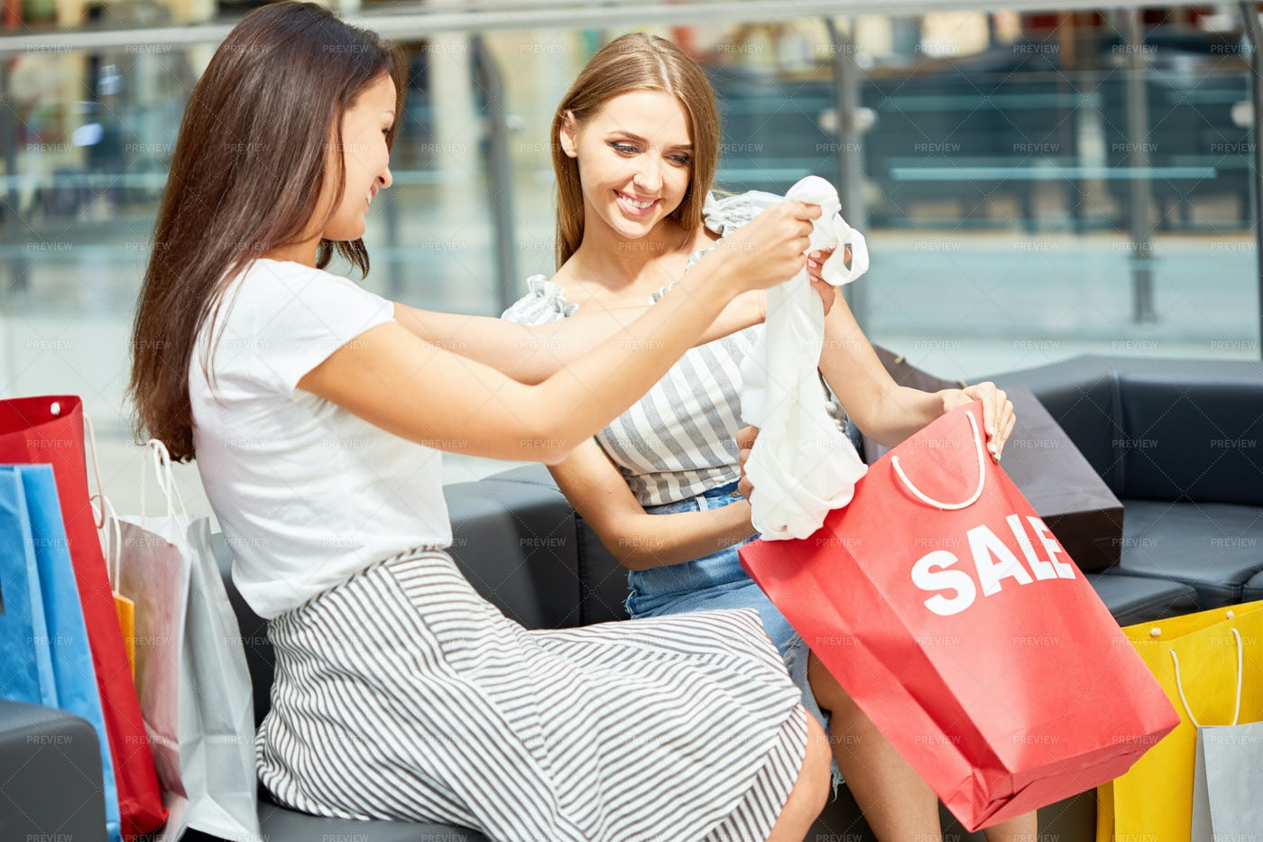 Girls Buying Clothes In Shopping...: Stock Photos
