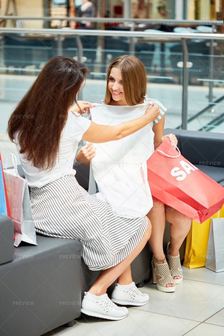 Girlfriends Shopping On Sale: Stock Photos