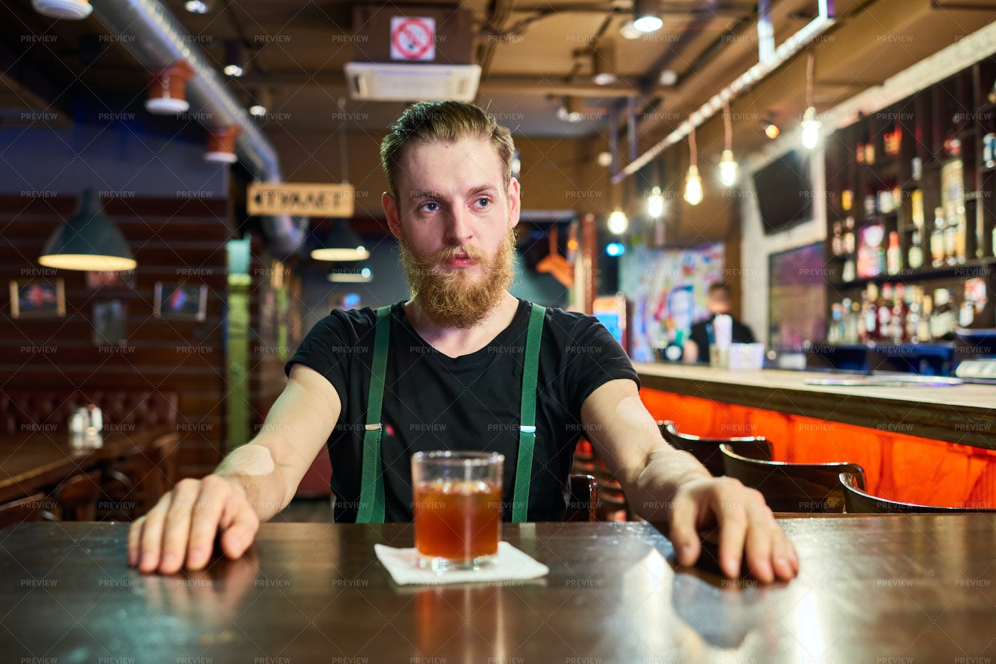 Bearded Man At Table In Pub: Stock Photos