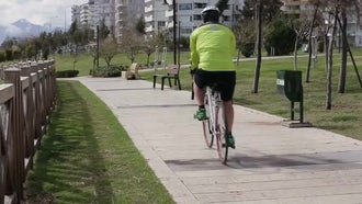 Man Cycling In The Park Outdoors: Stock Video