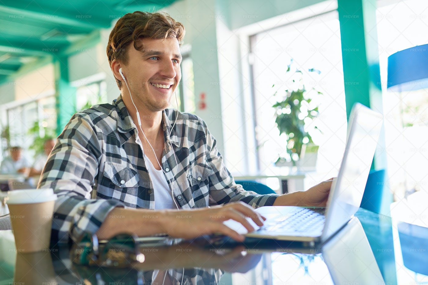 Happy Young Man Working With Laptop...: Stock Photos