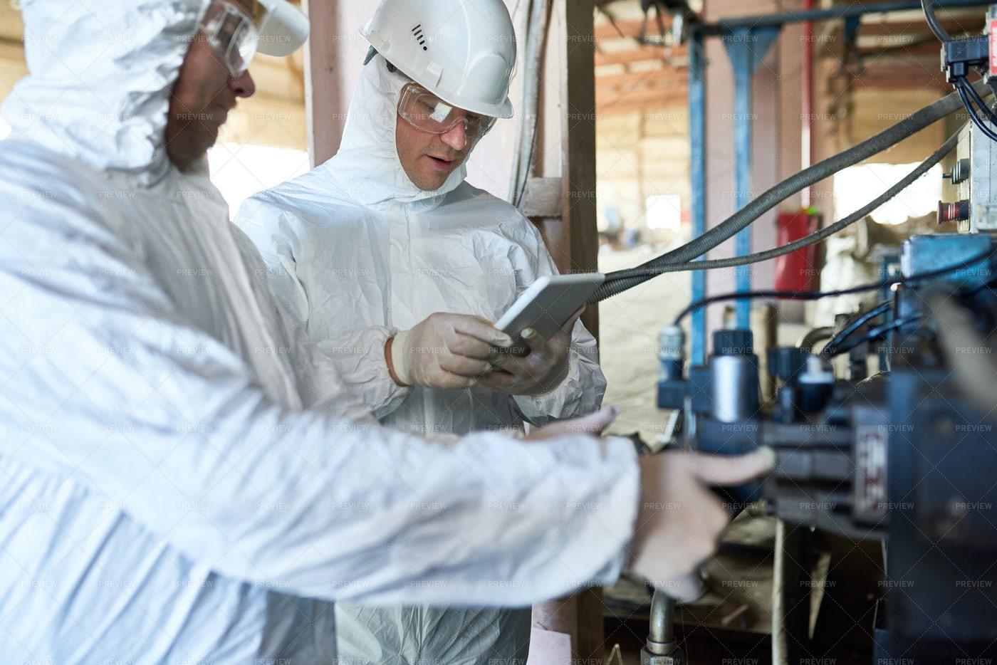 Workers On Biohazard Factory: Stock Photos