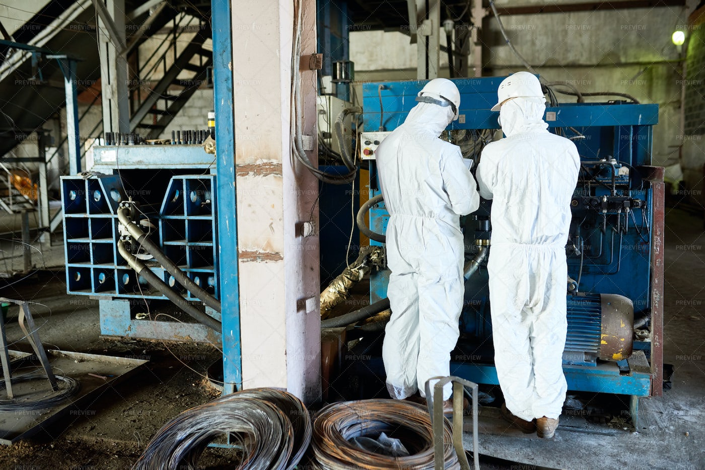 Two Workers On Biohazard Factory: Stock Photos