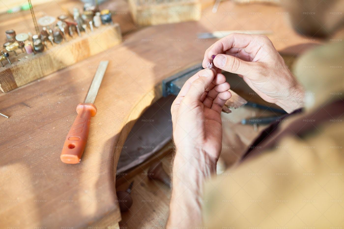 Jeweler Making Silver Decoration: Stock Photos
