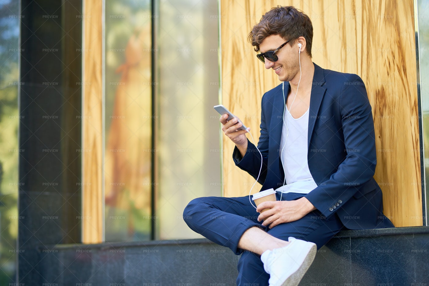 Stylish Young Man With Smartphone...: Stock Photos