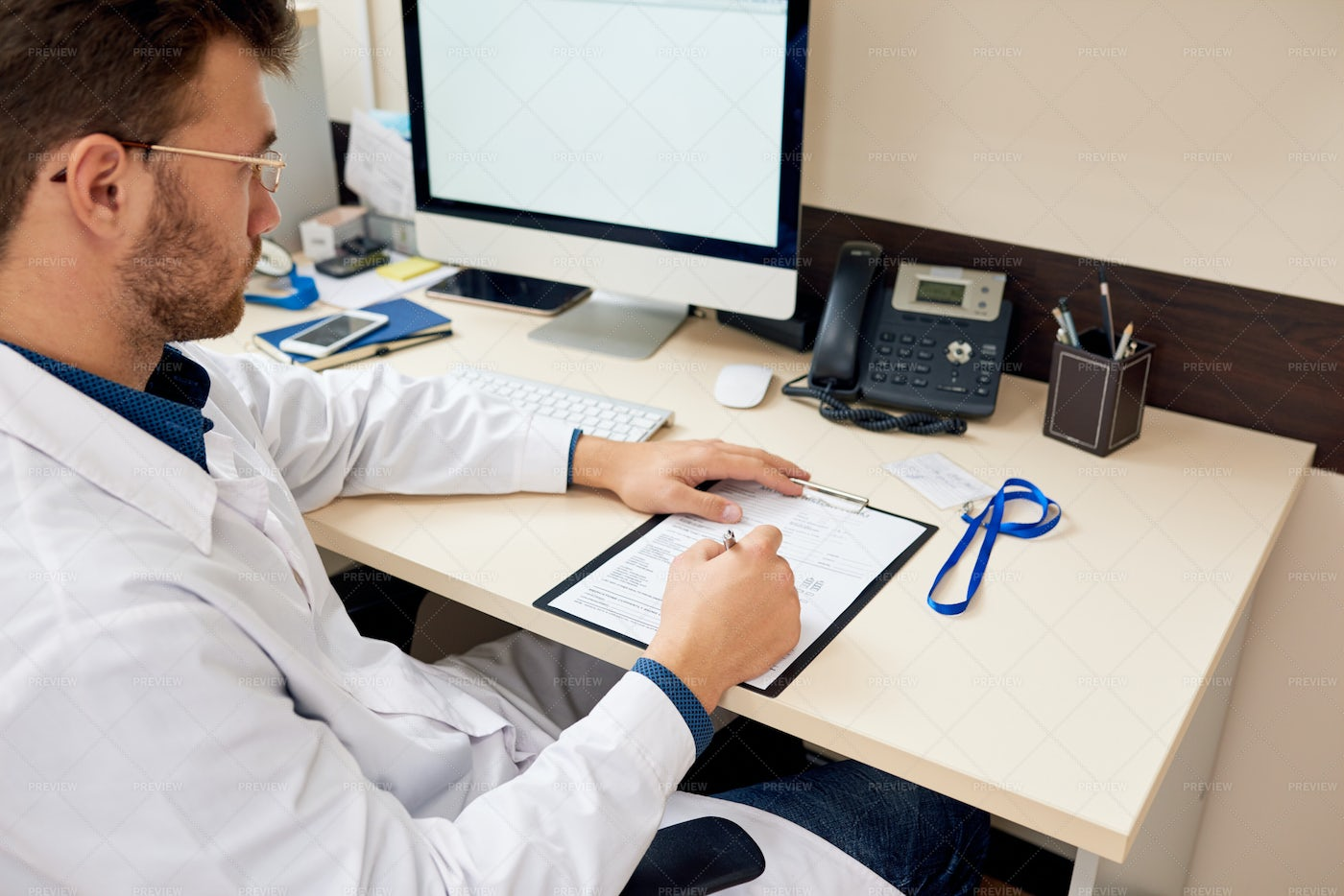 Doctor Working At Desk In Office: Stock Photos