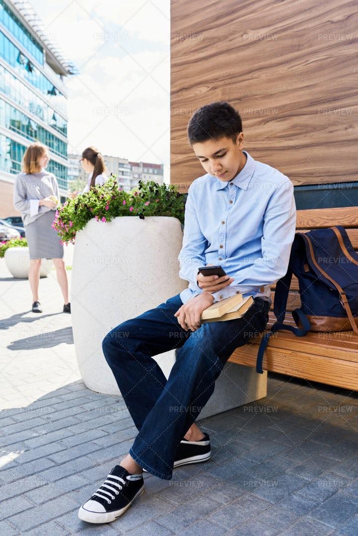 Teenage Boy Using Smartphone In...: Stock Photos