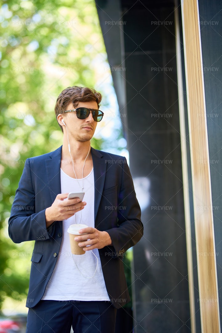 Handsome Young Man Walking In City: Stock Photos