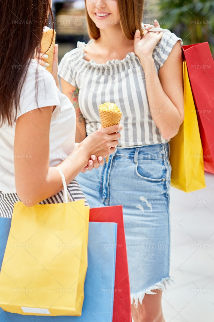 Two Young Women Shopping In Mall: Stock Photos