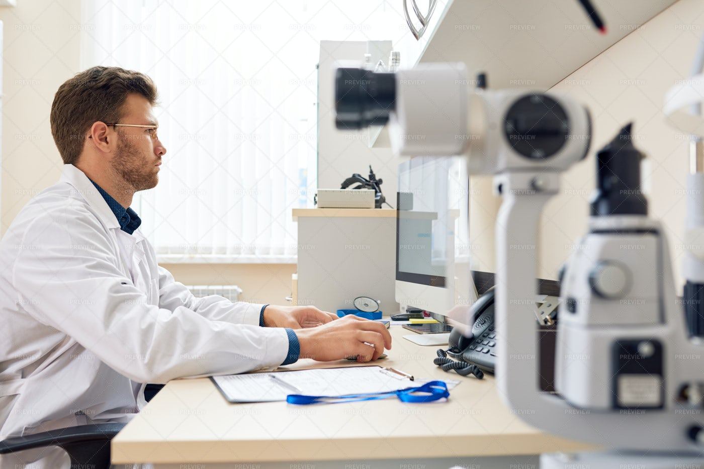Ophthalmologist Working With...: Stock Photos