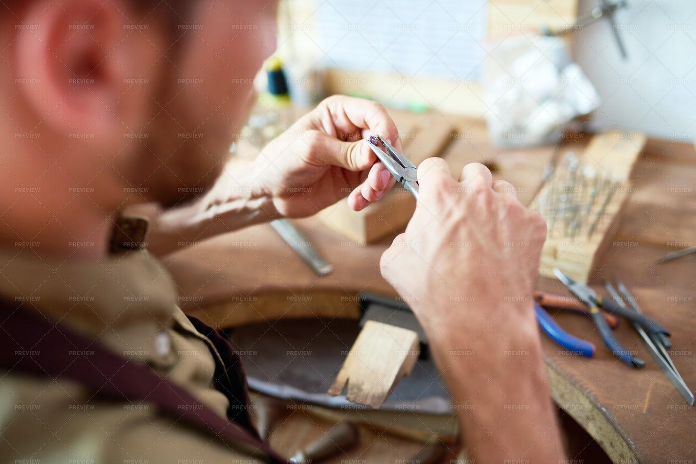 Goldsmith Making Ring: Stock Photos
