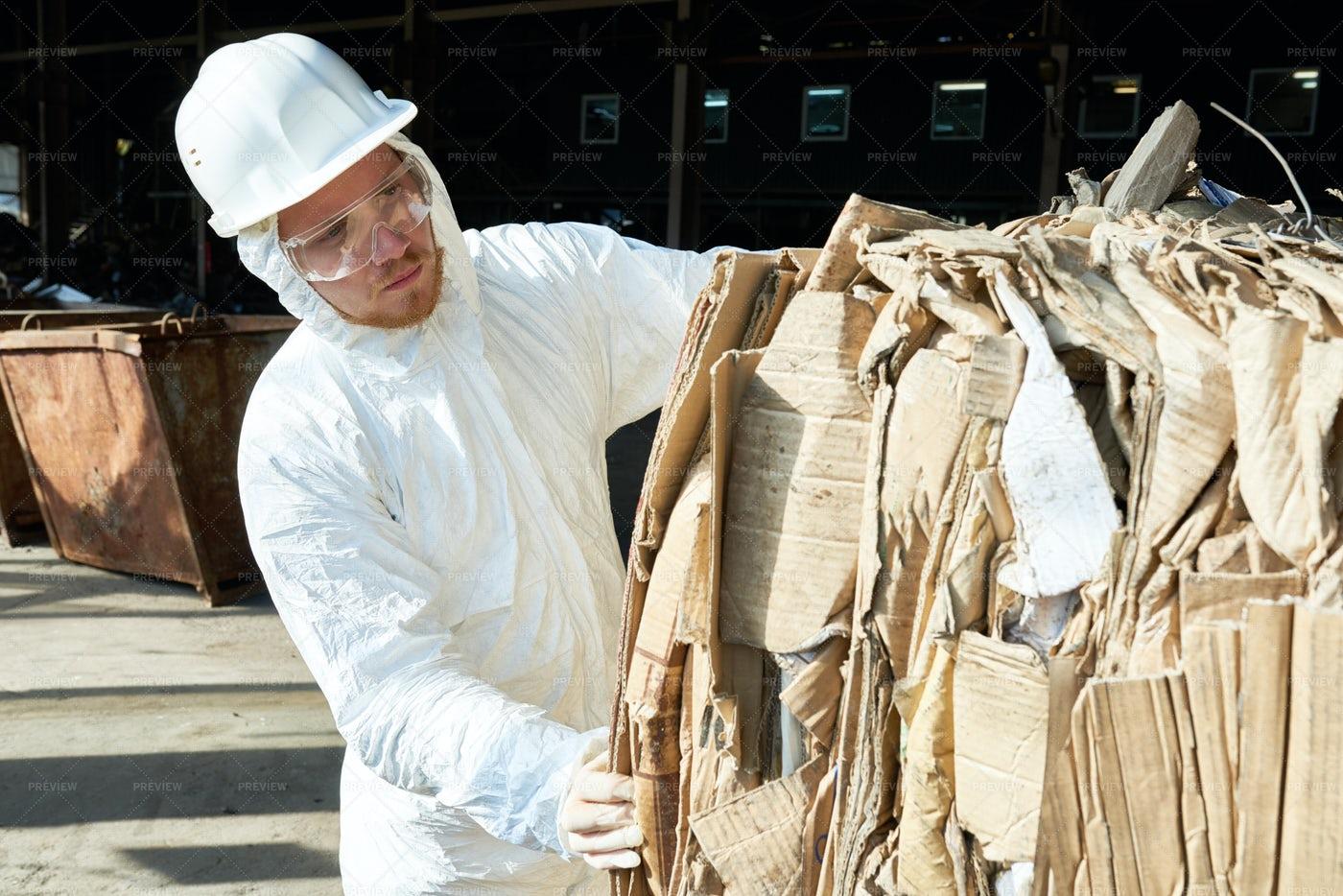 Worker In Hazmat Suit Sorting...: Stock Photos