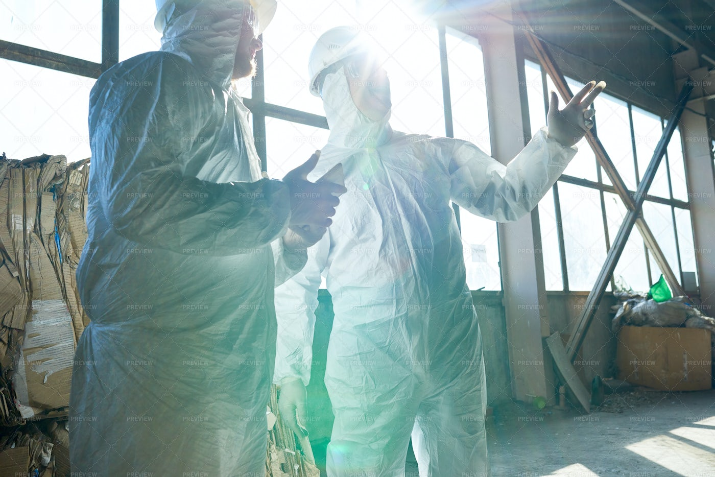 Workers In Sunlight At Modern Waste...: Stock Photos