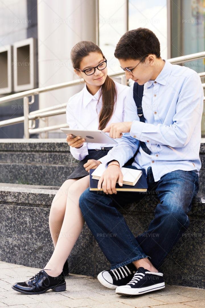 Schoolchildren Using Digital Tablet...: Stock Photos