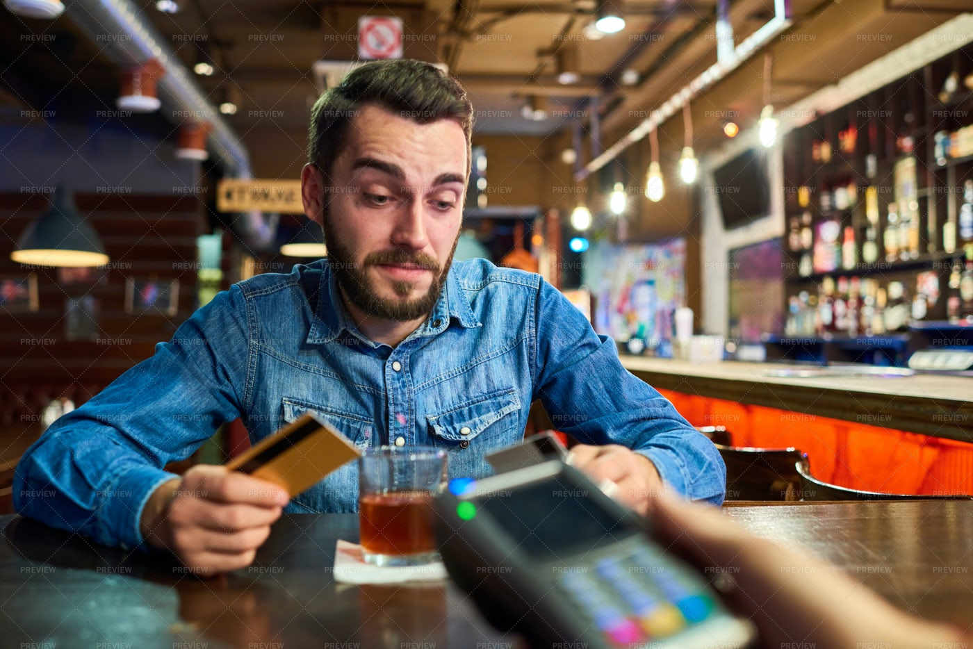 Drunk Man Paying Via Credit Card In...: Stock Photos