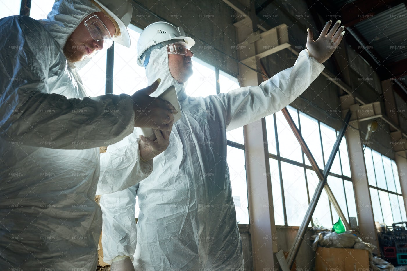 Workers In Protective Suits At...: Stock Photos