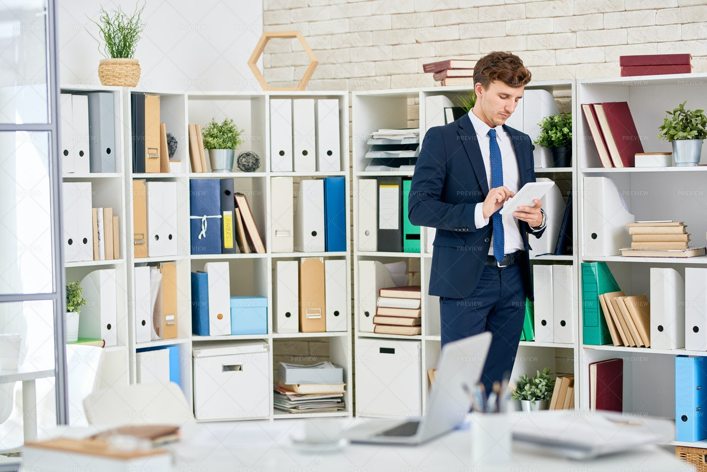 Handsome Businessman  In Office: Stock Photos